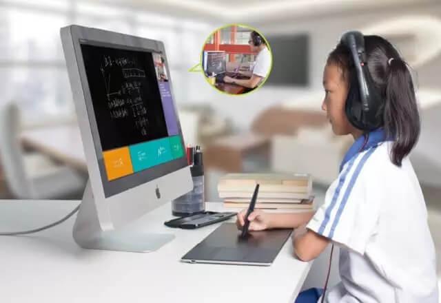 一个学生正在用Huion数位板在电脑上进行试题解答